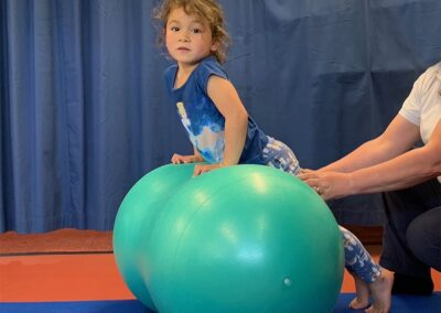 specialist physiotherapist teaching good posture, strength and improving balance for child